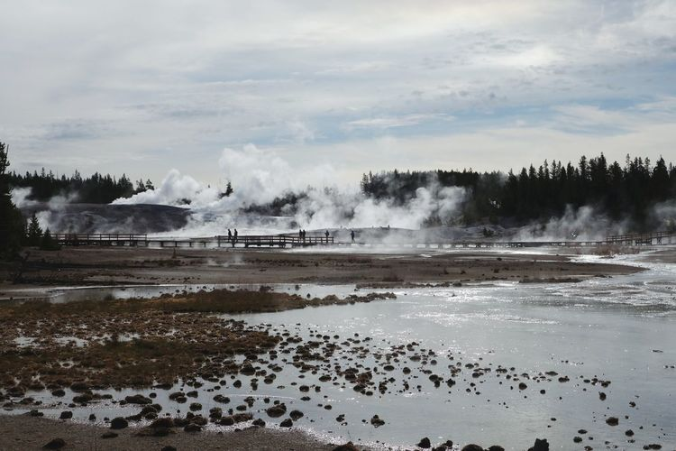 Steam Emitting From Geyser At Yellowstone National Park Against Sky