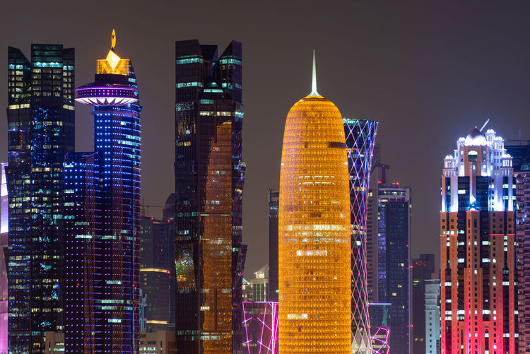 Illuminated buildings of doha city at night