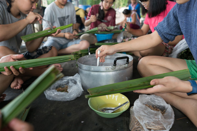 Rear view of people having food