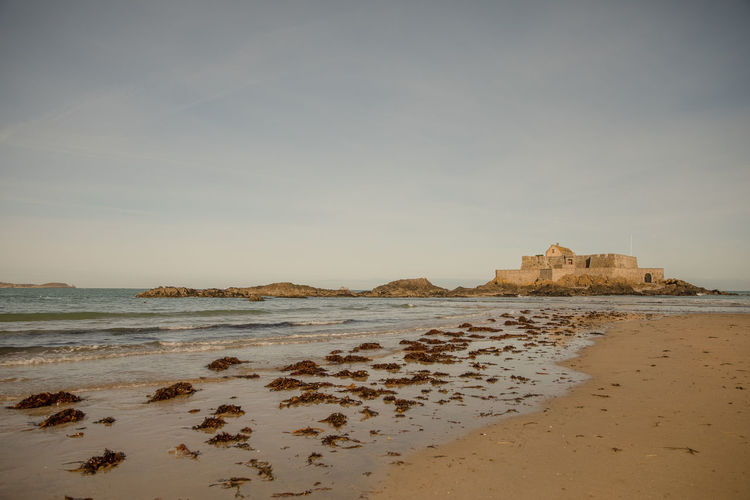 Saint-Malo beach with a view on Fort National Atlantic Ocean Bretagne Brittany Coastline English Channel France Saint-Malo Architecture Beach Coast Corsair City Fort National History Horizon Over Water Ille-et-vilaine Monument No People Outdoors Sand Sea Shore Sky Tranquility Travel Destinations Water