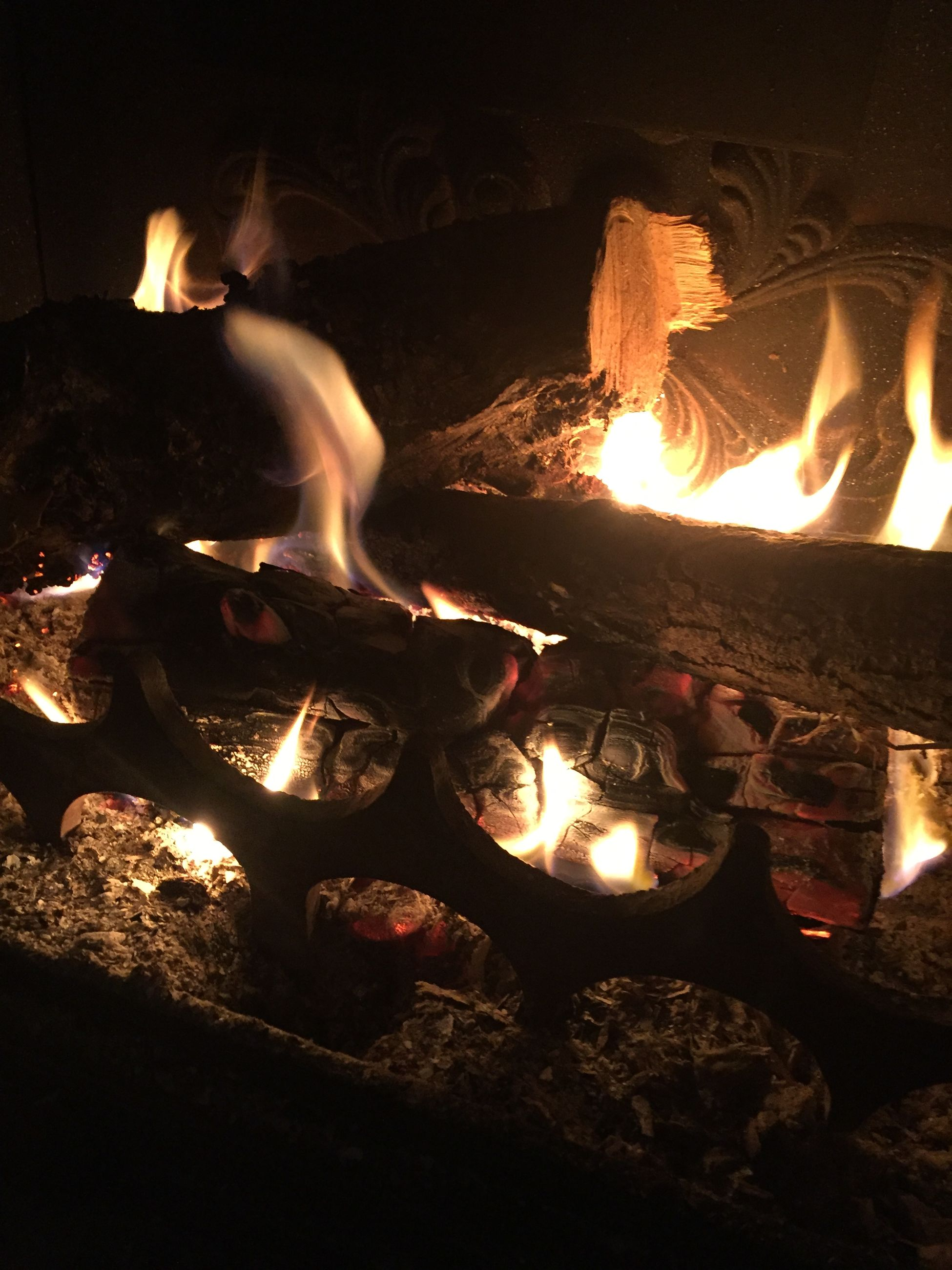 indoors, illuminated, flame, burning, night, glowing, candle, fire - natural phenomenon, dark, heat - temperature, lighting equipment, light - natural phenomenon, lit, darkroom, home interior, close-up, no people, reflection, high angle view, wood - material