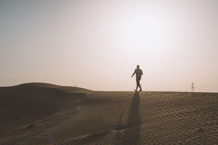 Adult Adventure Arab Arabian Beach Beauty In Nature Day Desert Dubai Full Length Healthy Lifestyle Nature One Person Only Men Outdoors People Sand Sand Dune Sport Sunlight Sunset UAE United Arab Emirates Walking Wellbeing