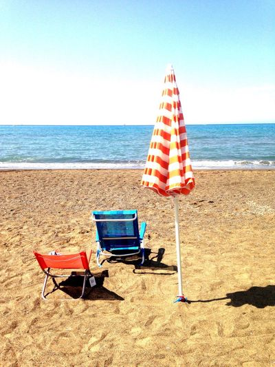 Fine Agosto A Marina Di Castagneto Carducci (Toscana) Sea Beach Horizon Over Water Sand Water Shore Nature Tranquility Beauty In Nature Tranquil Scene Scenics Summer Day No People Outdoors Chair Sky Clear Sky The Week On EyeEm Done That.