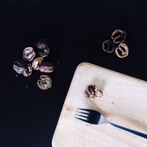 Nutshells And Fork On Cutting Board