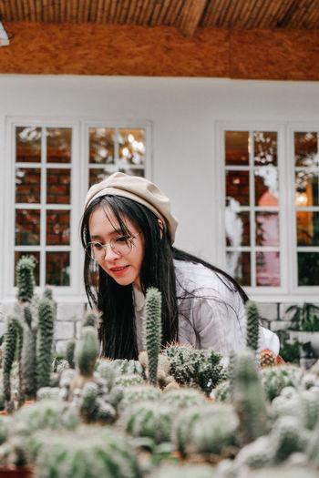 Smiling woman looking at cactus