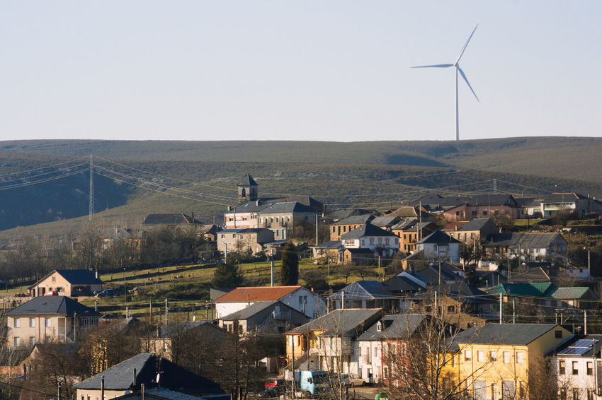 View of Brañuelas, village in León, Spain Architecture Brañuelas Building Exterior Clear Sky Eolicfarm High Angle View Hill House Mountain Residential Structure Roof Sky Town TOWNSCAPE Village Wind Energy Wind Farm Wind Mill