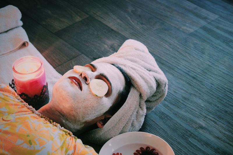 High Angle View Of Woman With Face Mask Lying At Spa