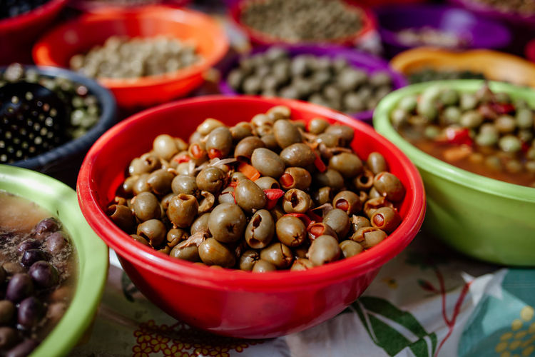High angle view of olives in bowl at market stall