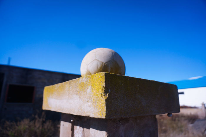 The 2018 World Cup is upon us 🙌 ⚽ 🏆 Soccer Ball Soccer Statue Blue Sky Clear Sky Outdoors Sunny Architecture Sunlight Focus On Foreground Copy Space Streetphotography Football Football Life Minimalarchy Minimalart Minimalobsession Minimalist Minimalmood Minimalistic Minimal Minimalism Mnmlsm
