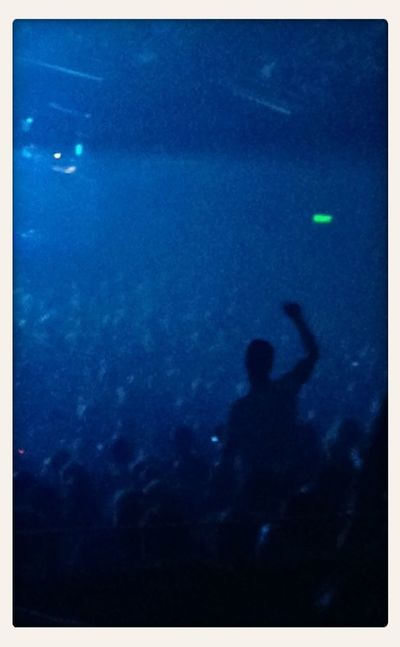 A fan enjoys the Pixies live at Sydney Opera House. Concert Fans Light And Shadow Silhouette