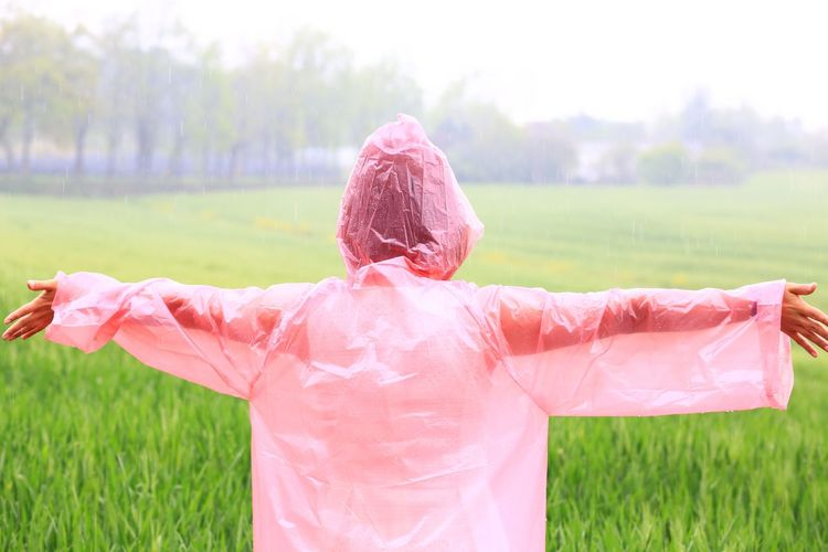 EyeEm Nature Lover EyeEmNewHere Fashion Rainy Days Taking Photos Tree Enjoying Life Field Focus On Foreground Grass Green Color Human Body Part Landscape Leisure Activity Lifestyles Nature One Person People Pink Color Plant Portrait Real People Three Quarter Length Women