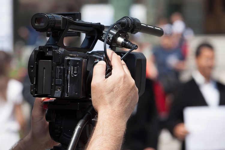 Filming an event with a video camera CameraMan Event Film Production Shoot Broadcasting Camera Operator Entertainment Equipment Filming Human Hand Journalism Mass Media Media Movıe News Outdoors People Professional Shooting Television Television Camera Tv Video Camera Video Production