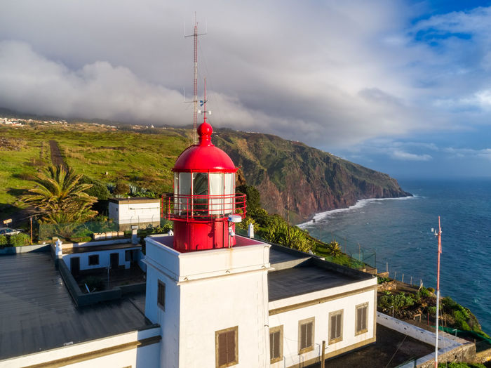 Aerial photo with drone of Ponta do Pargo Lighthouse with mountains on the background in Madeira Coastline Drone  Lighthouse Madeira Nature Panorama Panoramic Portugal Portuguese Travel Aerial Aerial View Architecture Best  Building Coast Ilha Island Landscape Mountain Ocean Outdoors Ponta Do Pargo Tower Travel