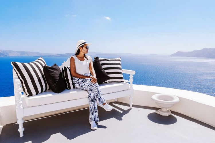Sea Only Women Adults Only One Woman Only One Person Adult Relaxation People Full Length Vacations Leisure Activity Day Outdoors Women Luxury Water Sitting Nature Young Adult One Young Woman Only Travel Santorini Santorini, Greece GREECE ♥♥ Weekend Activities