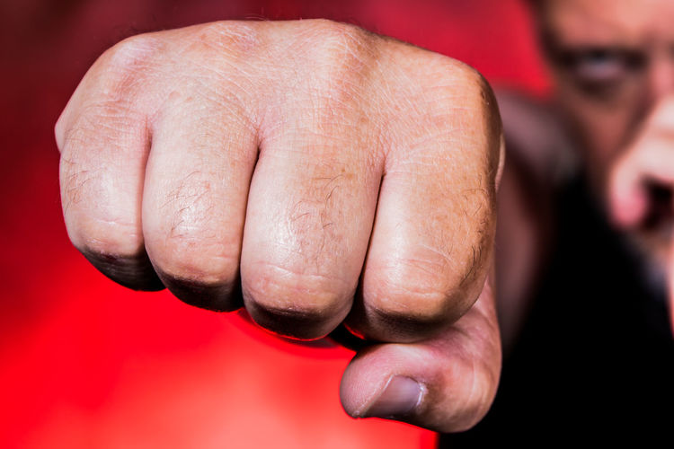 Close-Up Of Man Clenching Fist