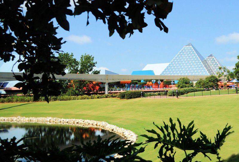 Let your imagination run wild at Disney DisneyWorld Framing Architecture Beauty In Nature Building Exterior Built Structure Day Epcot Family Fun Growth Monorail  Natural Framing Nature Outdoors Sky Tree Vacation Water World Of Imagination