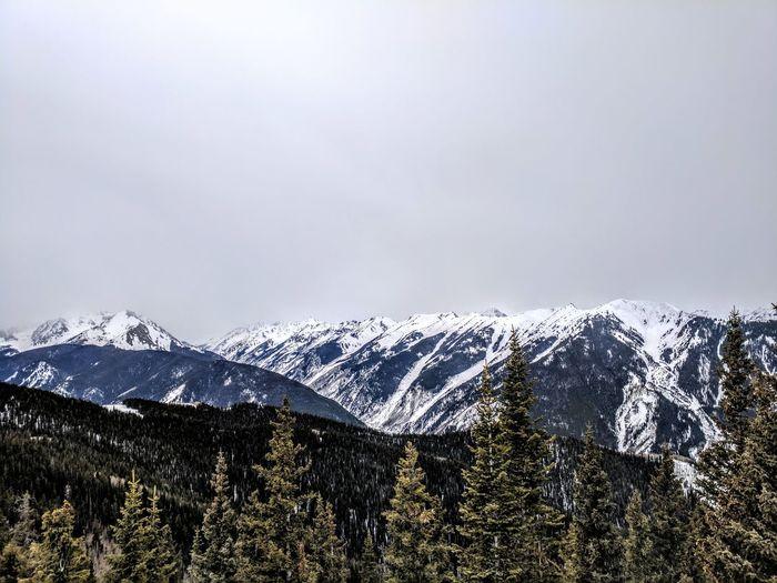 Grey skies Snow Snowcapped Mountain Mountain Peak Mountains Rocky Mountains Colorado Aspen Skiing Vacation Winter Outdoors