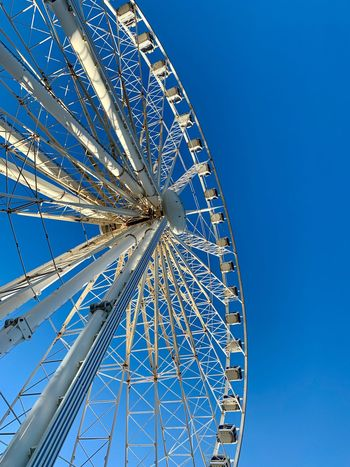 Wheels in the sky Liverpool Blue Clear Sky Amusement Park Low Angle View Amusement Park Ride Sky Built Structure Architecture Ferris Wheel No People Nature Arts Culture And Entertainment Outdoors Day Pattern Tall - High