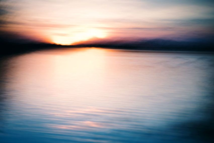 Sunstreak. Sunset Reflection Water Dramatic Sky Cloud - Sky Scenics Nature Backgrounds Tranquil Scene Beauty In Nature Idyllic Tranquility Sea Sky Abstract Dusk Ethereal Outdoors No People Multi Colored Beauty In Nature Icm Landscape Pentax Serenity