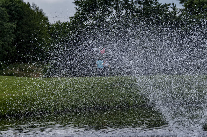 splashing Beauty In Nature Day Flood Golf Golf Course Grass Leisure Activity Motion Nature One Person Outdoors People Real People Splashing Spraying Tree Water