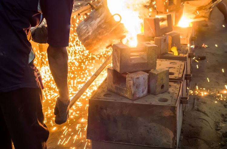 work humanThe blast furnace liquid metal fire spark with work human Burning Expertise Fire Pit Flame Food Foundry Glowing Heat - Temperature Human Hand Indoors  Industry Low Section Manual Worker Men Metal Industry Molten Motion Occupation One Man Only One Person Preparation  Protective Workwear Real People Working Workshop