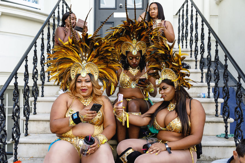 Carnival London Travel Adult Beautiful Woman Carnival - Celebration Event Clothing Costume Day Festival Front View Group Of People Hairstyle Incidental People Leisure Activity Lifestyles Looking At Camera People Portrait Real People Sitting Three Quarter Length Women Young Adult Young Women This Is My Skin The Street Photographer - 2018 EyeEm Awards