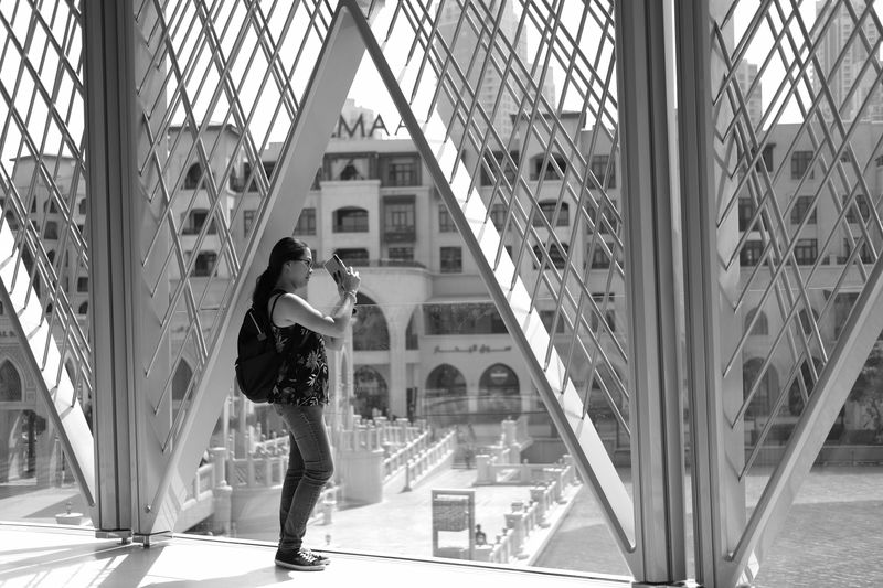 Street Portrait Fujifilm UAE Human Hand Engrgroundzero Portrait Of A Woman Street Fashion Street Portrait Black & White Dubai Mall Women Only Women Blackandwhitephotography EyeEmBestPics EyeEm Best Shots Eyeemphotography Built Structure Architecture Real People One Person Lifestyles Full Length Leisure Activity One Woman Only Building Exterior Day Modern Adults Only Outdoors Adult One Young Woman Only Photography Themes Young Adult People