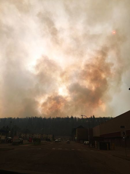 Smoke is rising, the sun is red. We are going out of downtown. Fortmcmurray Evacuation Wildfire IPhoneography
