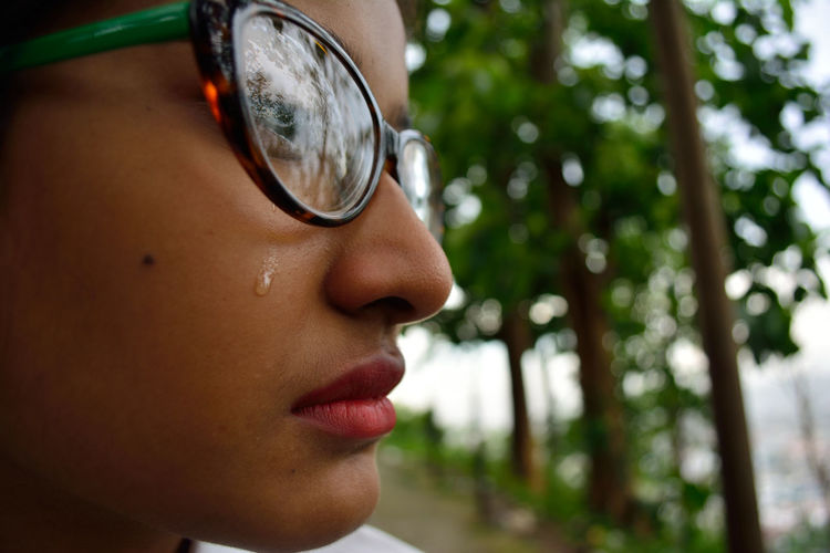crying EyeEmNewHere Sad Eyes Teardrop Beautiful Woman Close-up Crying Focus On Foreground Glasses Headshot Human Face Human Lips Lifestyles Looking Away One Person Portrait Real People Sad Sad Face Sadness Teenager Young Women A New Perspective On Life Human Connection