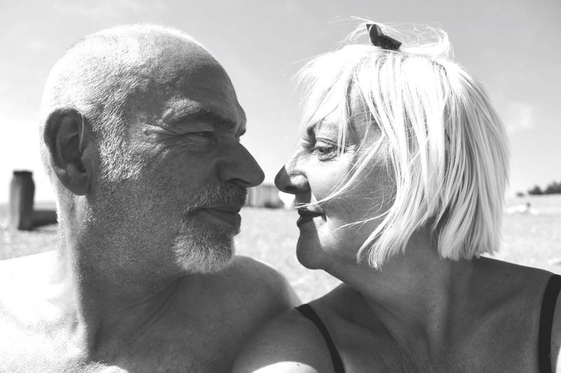 Close-up of mature couple at beach