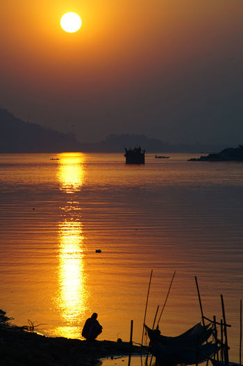 Beauty Of Brahmaputra Beauty In Nature Beauty Of Brahmaputr Brahmaputra Day Guwahati Indoors  Mountain Namami Brahmaputra Nature Nautical Vessel No People Orange Color Outdoors Reflection River Scenics Sea Silhouette Sky Sun Sunset Tranquil Scene Tranquility Transportation Water
