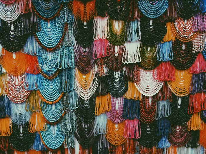 Full frame shot of multi colored jewelry for sale in market