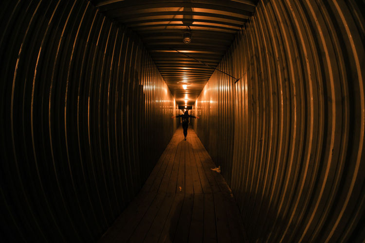 Rear view of man in tunnel