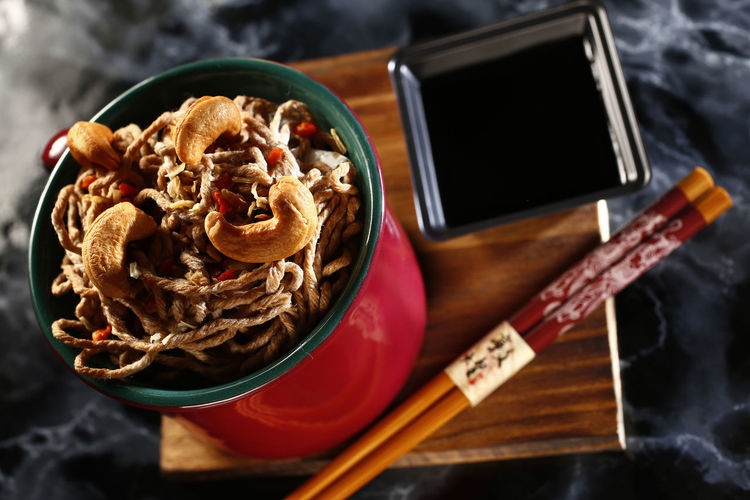 yakisoba Food Food And Drink Close-up No People Indoors  Healthy Eating Freshness Ready-to-eat Still Life High Angle View Table Yakisoba Bowl Kitchen Utensil Spoon Wellbeing Eating Utensil Meal Breakfast Focus On Foreground Drink Shoyu