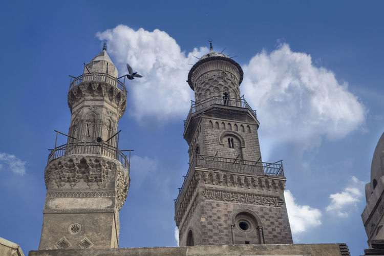 Flying Pigeon Architecture Belief Building Building Exterior Built Structure Cairo, Egypt Clock Cloud - Sky Day El Moez Street Cairo Flying Dog History Low Angle View Nature No People Outdoors Place Of Worship Religion Sky Spire  Spirituality The Past Tower Travel Travel Destinations
