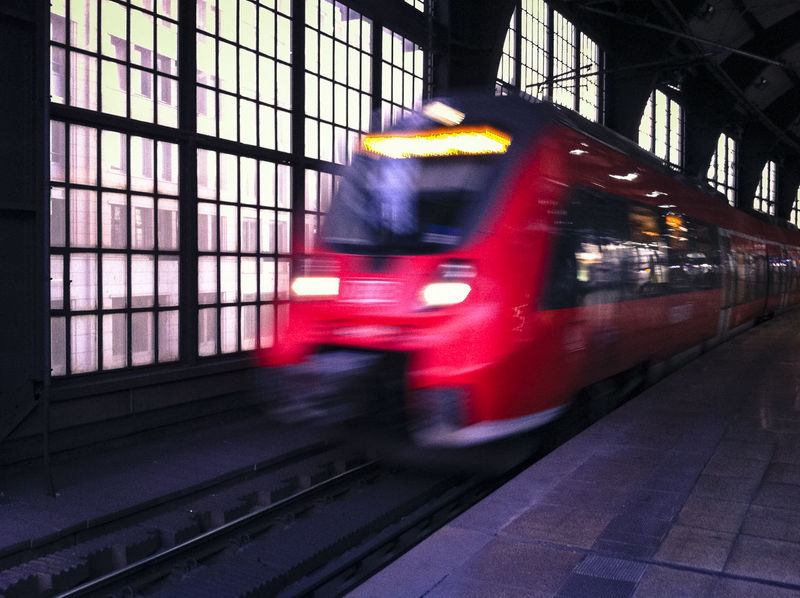 Red train departing from Friedrichstrasse Station Blurred Motion City Contemporary Friedrichstrasse Station Glass Illuminated Indoors  Mode Of Transport Public Transportation Red Train Transportation Travel