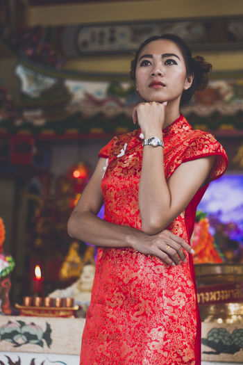 Chinese Fashion Shooting. ASIA Asian  Dress Fashion Beautiful Woman Chinese Chinese New Year Day Focus On Foreground Front View Leisure Activity Lifestyles Looking At Camera One Person Outdoors People Portrait Real People Red Standing Traditional Young Adult Young Women