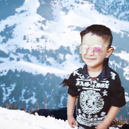 Full length of boy standing in snow