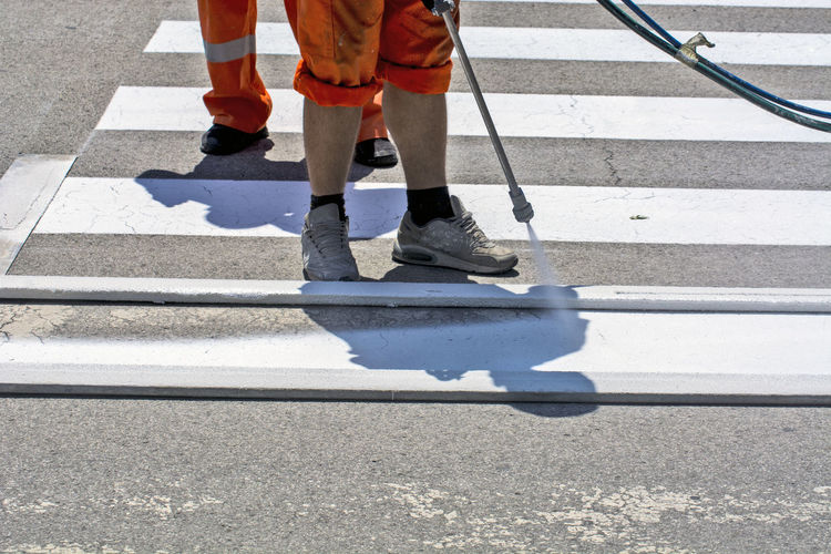 Low section of people making zebra crossing