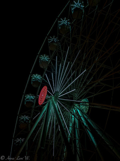 Ferris Wheel Built Structure Amusement Park Architecture Amusement Park Ride Nature Western Script Communication Text No People Illuminated Metal Arts Culture And Entertainment Night Outdoors Travel Destinations Low Angle View Sign Tourism Nightlife Fairground Sky The Week on EyeEm EyeEmNewHere EyeEm Best Shots