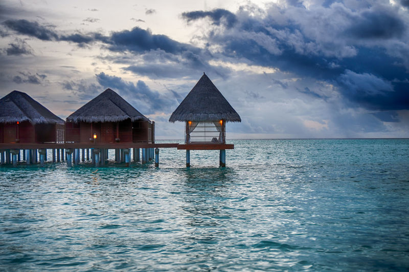Maldives resort ASIA Building Clouds HDR Horizon Over Water Landscapes Maldives Ocean Overwater Bungalow Resort Sea Sky Sky And Clouds Sunset Thatched Roof Water Waterscape The Great Outdoors - 2016 EyeEm Awards