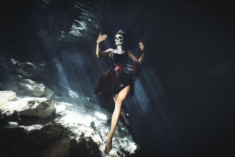 Water One Person Women Young Adult Rock Adult Nature Dress Rock - Object Young Women Clothing Full Length Sea Fashion Solid Beauty Underwater Real People Beautiful Woman Outdoors Hairstyle Flowing Water