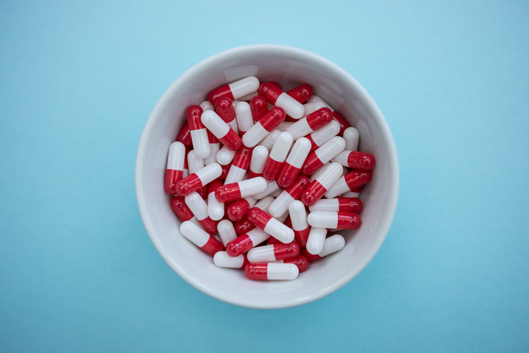 Drugs pills capsules Drugs Pill Pills Table Capsule Capsules Medicine Medical Background Red Color Top View Above Prescription  Healthcare And Medicine Minimal Concept Dose White Studio Shot Colored Background Indoors  Close-up Plastic Headache PainKiller Sick Sickness Vitamin Pharmacy Pharmaceutical