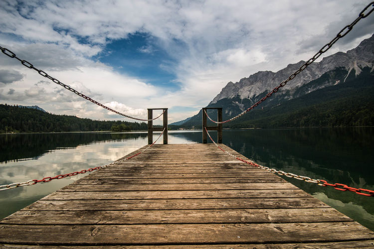 footbridge over lake Beauty In Nature Bridge - Man Made Structure Cloud - Sky Connect Day Footbridge Lake Landscape Mountain Nature No People Outdoors Scenics Senic View Sky The Way Forward Tourism Travel Travel Destinations Tree Vacations Water