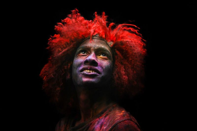 The smile from the festival of HOLI Festival Of Colors Holi Live Portrait Colorful Portrait Black Background Headshot People Looking At Camera Paint Redhead Face Paint Front View Multi Colored Emotion Hairstyle Close-up