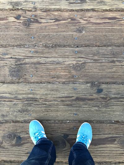 …at Santa Monica Pier. Pier Looking Down Low Section Human Leg Shoe Body Part One Person Real People Jeans Wood - Material Outdoors Standing