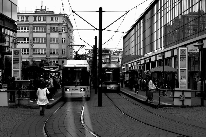 Berlin Blackandwhite Architecture Building Exterior Built Structure City Mode Of Transportation Transportation Street Rail Transportation Track Building Railroad Track Cable Car Day Public Transportation Land Vehicle Incidental People Sky Nature Real People Men The Street Photographer - 2018 EyeEm Awards