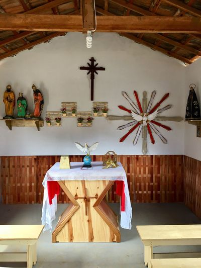Religion Spirituality Ceiling Cross Table Indoors  Wood - Material Place Of Worship Sculpture Statue Hanging Architecture Altar No People Day Church Small Church Inside Church