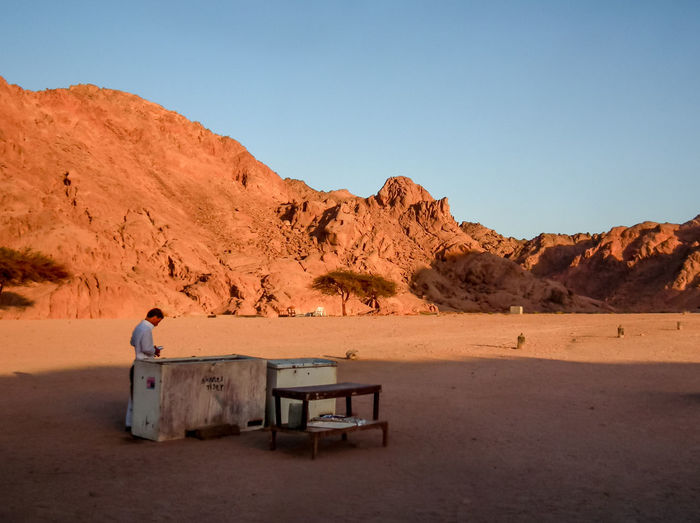 Rocky Real People Barren Bedouin Mountains Day Desert Sinai Egypt Sand Dry Wasteland Peaks Hills Blue Sky Cooking Cooler Colour Image World Travel Tree Sand Telling Stories Differently The KIOMI Collection One Person Table