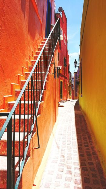 colorful town.. Viaje Mexicolors Mexico De Mis Amores Mexico_maravilloso Mexico Travel Photography Travelphotography Travelingtheworld  Traveltheworld Central America Walking Walking Around The City  TOWNSCAPE Colors My favorite place Full Of Colors Beautiful Place Shadow Sunlight Steps And Staircases Sky Architecture Built Structure Spiral Staircase Stairway Alley Staircase Narrow Stairs Adventures In The City